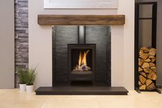 The Fireplace Studio offers traditional & contemporary gas stoves & electric stoves. Our showrooms are ideally situated for customers in Nottingham & Derby. Electric Stove Fireplace, Fireplace Feature Wall, Wood Burner Fireplace, Fireplace Gallery, Slate Fireplace, Home Fireplace, Living Room With Fireplace, Fireplace Design, My Living Room