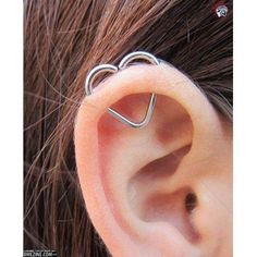 a twist on the industrial piercing <_< this isn't even close to an industrial bar peircing... its an orbital just shaped like a heart... <_<...