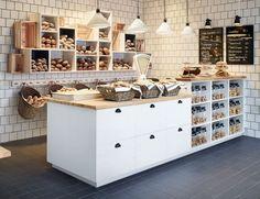 Bakkerij met open bovenkasten met vers gebakken brood en een toonbank met lades en open planken