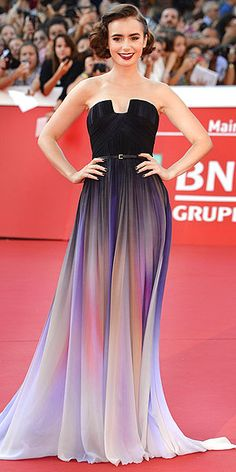 The Year's Best Dresses | LILY COLLINS | A dress doesn't always need sequins to stand out. All eyes were on Collins at the Rome premiere of Love, Rosie in October thanks to this breathtaking purple ombré Elie Saab Couture gown.