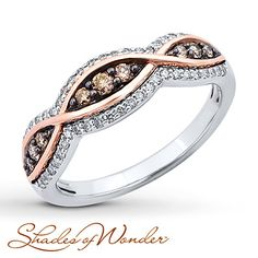 Ribbons of 10K rose gold weave along a band of 10K white gold in this memorable ring for her from Shades of Wonder™. Round brown and white diamonds adorn the fascinating ring, which has a total diamond weight of 3/8 carat. Earthy and captivating, the hues of Shades of Wonder™ diamonds are rare indeed. Diamond Total Carat Weight may range from .37 - .44 carats.