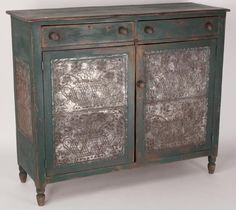 """WYTHE CO., VALLEY OF VIRGINIA PAINTED POPLAR PIE SAFE, rectangular top above two dovetailed drawers and two doors, each door with an applied joined-tin panel hand-punched in the urn-over-urn pattern, each end with an applied single-piece tin panel punched with the same urn as on the front but with fully developed flowers, the whole raised on short turned feet. Restored green-painted surfaces. Attributed to the Rich Family shop. 1830-1880. 46 1/2"""" H, 54 1/2"""" W, 19 1/2"""" D."""