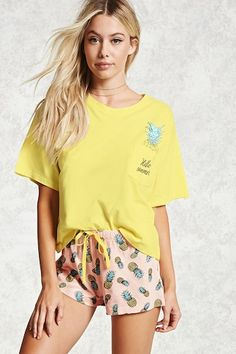 b5b05601d0bb A PJ set featuring a knit tee with a chest patch pocket with a pineapple and