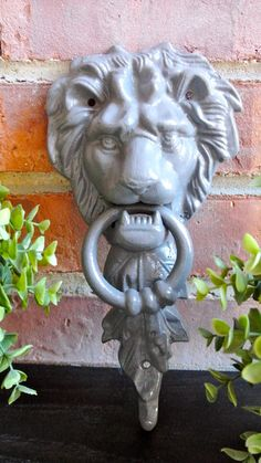 Elegant Cast Iron Lions head door knocker. This is definitely a statement piece for your door! Make your guests welcome from the moment they step threw your door! Hand painted and sealed for you and your homes protection!  Can also be used as a towel hanger in the bathroom! Details: ✿ Hand painted & sealed for your protection ✿ Made of cast iron. ✿ Easy to hang.You will need to provide 3 screws to secure this to your door. ✿ Measures approx. 11 H x 5 W ✿ Listing shown in color Winter Grey...