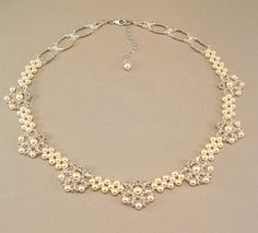 Regal Elegance Woven Bridal Necklace - Ivory Pearls and Clear Swarovski Austrian Crystal with silver accent beading on Etsy, £83.59