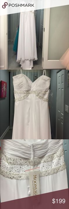 NWT Moonlight Bridal white Wedding Dress 18 Brand new with tags white wedding dress by moonlight bridal in chiffon with empire waist size 18. Very clean with a small sweep train. Strapless but includes spaghetti straps. Fits bust 44.5 , waist 34.5, hips 47 inches.  Make an offer or bundle with another item for 10% off of your entire order. Moonlight Bridal Dresses Wedding