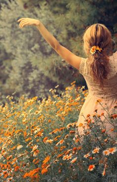 standing in a field of orange flowers wearing this dress.