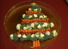 Snack idea. Christmas Tree Vegetable Tray but with cucumbers too. Dip spread in bottom like 'snow'