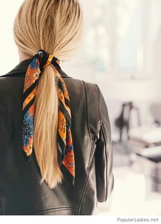 Blonde hair and a printed scarf