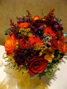What a gorgeous fall centerpiece by our in house floral designer! See more at facebook.com/flowersbythewestwood #fall #wedding #centerpiece #flowers
