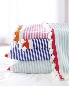 love these striped linens with mini pom pom fringe! // bedding