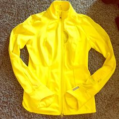 Yellow Zella running jacket This jacket is in great condition and only been worn a few times! The jacket has a zipper all the way down the front, a small zip pocket on the left arm, and a small pocket on the front left chest of the jacket.  The back of the jacket and part of the sleeves has mesh breathable material on it to keep you cool while you run . Zella Jackets & Coats