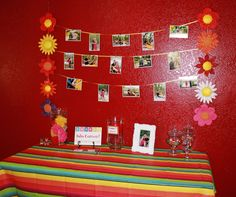 The entry table for a Mexican theme bridal shower! Great way to show off engagement pictures!