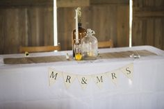 Head table at Kelley Agricultural farm and museum in Kokomo, In mr and mrs sign yellow and white wedding Yellow Wedding, Farm Wedding, Kokomo Indiana, Burlap Runners, Ecommerce Hosting, Wedding Details, Wedding Inspiration, Table Decorations, Ring