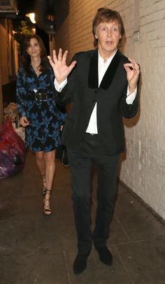 Paul McCartney poses as he's caught on camera with wife Nancy