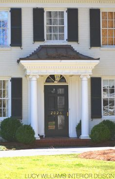 Beautiful Homes of Charlotte, NC - cream painted brick with navy blue shutters
