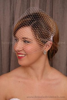 A simple bandeau birdcage veil.  Easy to make, and made even more beautiful in a soft champagne color