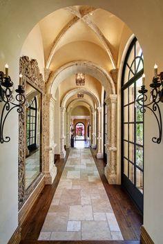 "Mediterranean-style Scottsdale home of Sam & Josie Fratantoni (Fratantoni Luxury Estates). Gallery hall features groin vaults and walnut floors with a unique travertine ""runner""."