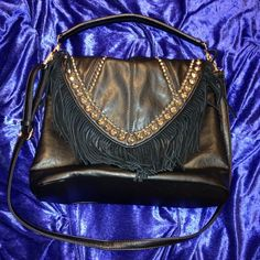 Studded fringe crossbody Black, fringed crossbody with golden studs. Very spacious bag with various pockets. Handle is detachable and strap is both detachable and adjustable! Measures 4 inches wide, it can fit a lot! The condition is perfect! I only used it once. No trades or very low offers please! Bags Crossbody Bags