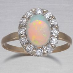 Vintage Opal Ring. Obsessed with Opal! I have the most beautiful birthstone ever (: