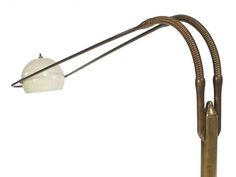 Articulated Floor Lamp by Angelo Lelli | From a unique collection of antique and modern floor lamps  at https://www.1stdibs.com/furniture/lighting/floor-lamps/