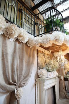 Here's the side view, looking up to the balcony above the Bridal Table. I'm totally loving the old church window frames and vintage door...gives off a whimsical twist on tradition! love it