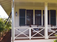 Who wouldn't love to relax here on the porch of the cottage in Hawaii. And check out the bifold louver, so all 3 windows can be covered when the shutters are closed. (and aren't those great Bermuda shutters alone the side?)