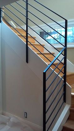 Looking for Modern Stair Railing Ideas? Check out our photo gallery of Modern Stair Railing Ideas Here. Cable Stair Railing, Black Stair Railing, Wrought Iron Stair Railing, Stair Railing Design, Metal Stairs, Staircase Railings, Modern Stairs, Handrail Ideas, Bannister