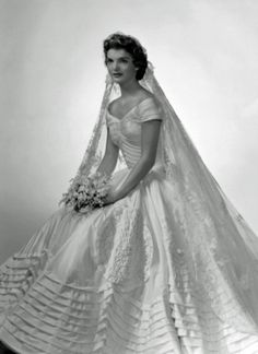 Jacqueline Kennedy Onassis in her wedding gown 12 September .cited as iconic and one of the best-remembered bridal gowns of all time. The wedding gown was the creation of Ann Lowe ft) of ivory silk taffeta. Jacqueline Kennedy Onassis, Jackie Kennedy Wedding, Jaqueline Kennedy, Jackie O's, John Kennedy, Caroline Kennedy, Jacklyn Kennedy, Celebrity Wedding Dresses, Celebrity Weddings