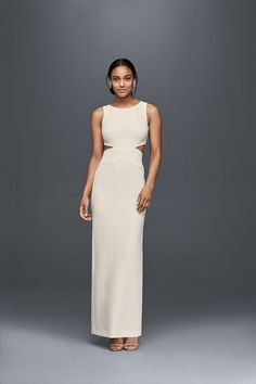 Sleek side cutouts and an open back give this Nicole Miller wedding dress a modern edge. Available at David's Bridal.