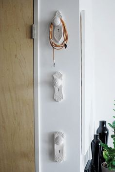 Antique door knobs as hooks...love!