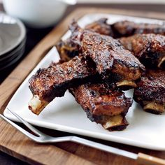 These beef ribs—leftovers from the giant rib roast—are incredibly luscious. Chef Tim Love douses them in his sweet and tangy homemade barbecue sau...