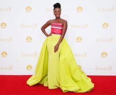 """""""Mad Men"""" star Teyonah Parris brightens up the red carpet in neon green and pink flowing gown."""