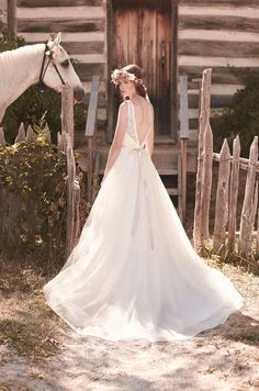 2063 | Mikaella | by Paloma Blanca | Available at Lulu's Bridal Boutique | Lulu's Bridal | Dallas, Texas | V Neckline | V Back | Lace | Organza | Sash | Bow | Open Back | A Line | Natural Waist | Plunging |