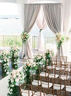 Gorgeous ceremony curtain and ivory and blush florals