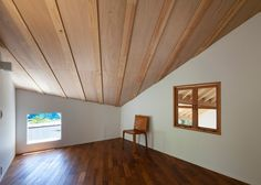 Interior shot of a Japanese house designed to frame views of the surrounding mountains.