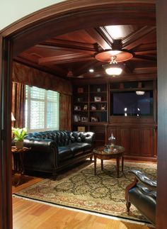 Cherry Paneled cigar room with a smoke eater and barrel vaulted stone wine room are the main attraction in this Gardner/Fox basement renovation