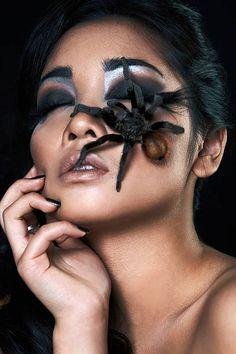 portrait of beautiful asian girl with spider stock photo
