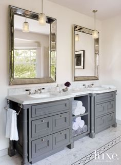 in the master bathroom rosenfeld hung a pair of midcentury nickeland crystal grey bathroom bathroom