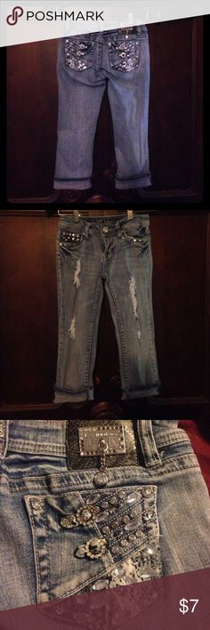 Blinged out distressed cropped jeans Super cute distressed cropped jeans with tons of bling! Size 3. Brand is L.A. Idol USA. A few missing stones on front button as shown in 4th pic. L.A. idol USA Jeans Ankle & Cropped