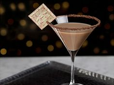Peppermint Square Martini 1½ shots of vodka ½ shot of chocolate liqueur ½ shot of creme de cacao chocolate syrup (optional) 1 Ghirardelli Peppermint Bark SQUARES™ DIRECTIONS Pour ingredients into shaker filled with ice, then pour into chilled martini glass. Garnish with an unwrapped Ghirardelli Peppermint Bark SQUARES. For an added touch, rim the glass in chocolate syrup and chocolate shavings.
