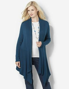 Soft and warm, yet surprisingly lightweight, this openfront cardigan is just the piece you need to complete your love-to-layer style. A mix of horizontal, vertical and diagonal ribbing gives you extra fit. Draping hem has an asymmetrical cut for added length on each side. Complete with long sleeves with ribbing at the ends. Catherines tops are perfectly proportioned for the plus size woman. catherines.com
