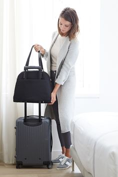 The O.G. is a high-quality lightweight travel bag that is designed for the demands of the on-the-go lifestyle. Thoughtfully designed with features to help you stay organized including a built in laptop sleeve, interior pockets, side shoe pocket and back panel suitcase sleeve. #loandsons