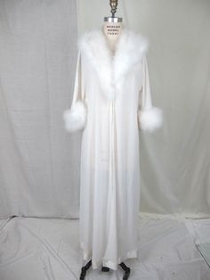 FOR THE HONEYMOON   1950s 60s  White Marabou Feather and Chiffon Robe. $125.00, via Etsy.