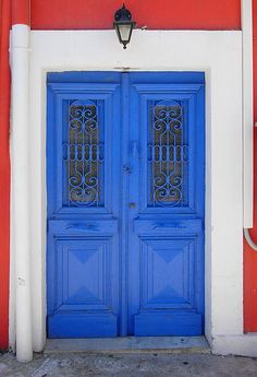 This royal blue door with it's grilled windows is so pretty.