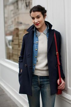 street style by the sartorialist. denim jacket layered under wool coat. Red bag makes it. The Sartorialist, Look Fashion, Winter Fashion, Layered Fashion, Layering Outfits, Layering Clothes, Mode Inspiration, Fashion Inspiration, Her Style