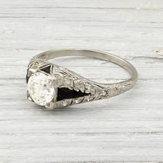 Vintage .95 Carat Diamond & Onyx Engagement Ring. $8,400.00, via Etsy.