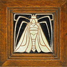FREDERICK H. RHEAD (1880 - 1942)  RHEAD (Santa Barbara)  Rare tile decorated in cuerda seca with moth, white and mirror black glazes, 1914-17;