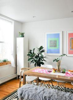 Design*Sponge/Sneak*Peek - white side cabinet - store hosting dinner plates / bowls, wine glasses and wine and linens.