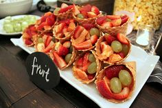 cute idea for serving fruit at a party-think I would paint chocolate inside the cones so the fruit didn't get them soggy